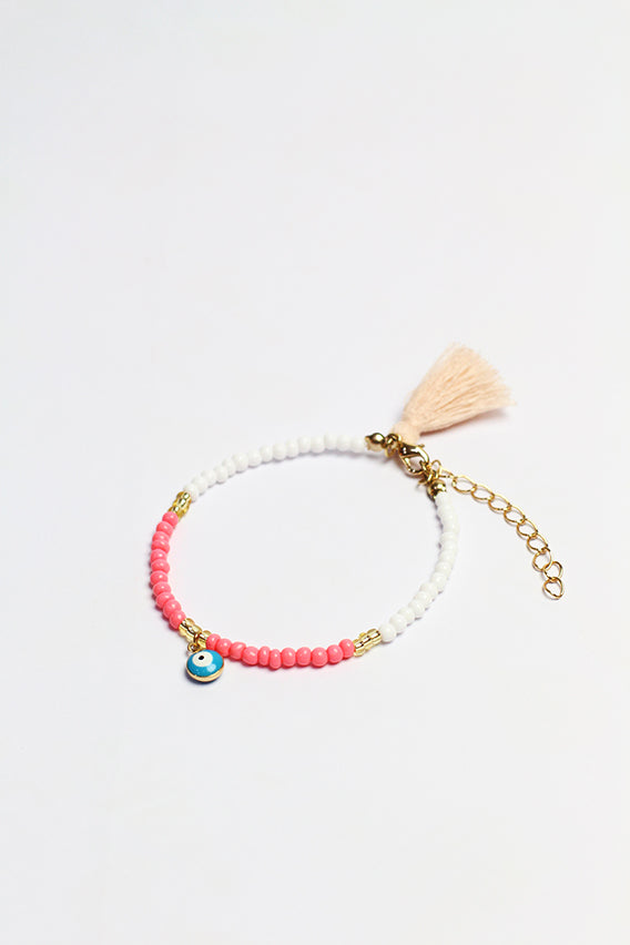 Pink/white beads bracelet with blue eye pendant & peach tassel