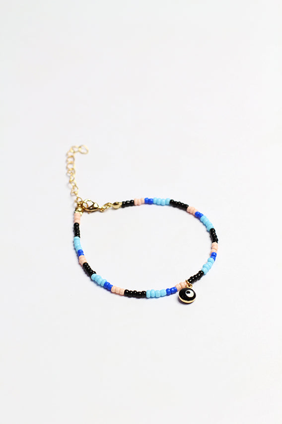 Multi color beads bracelet with black eye pendant