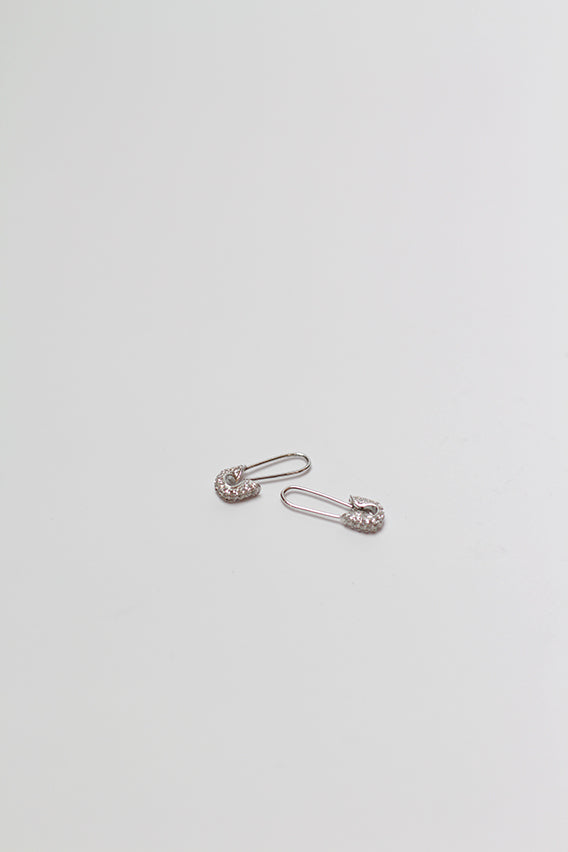 Tom Binns - White pave mini safety pin earrings