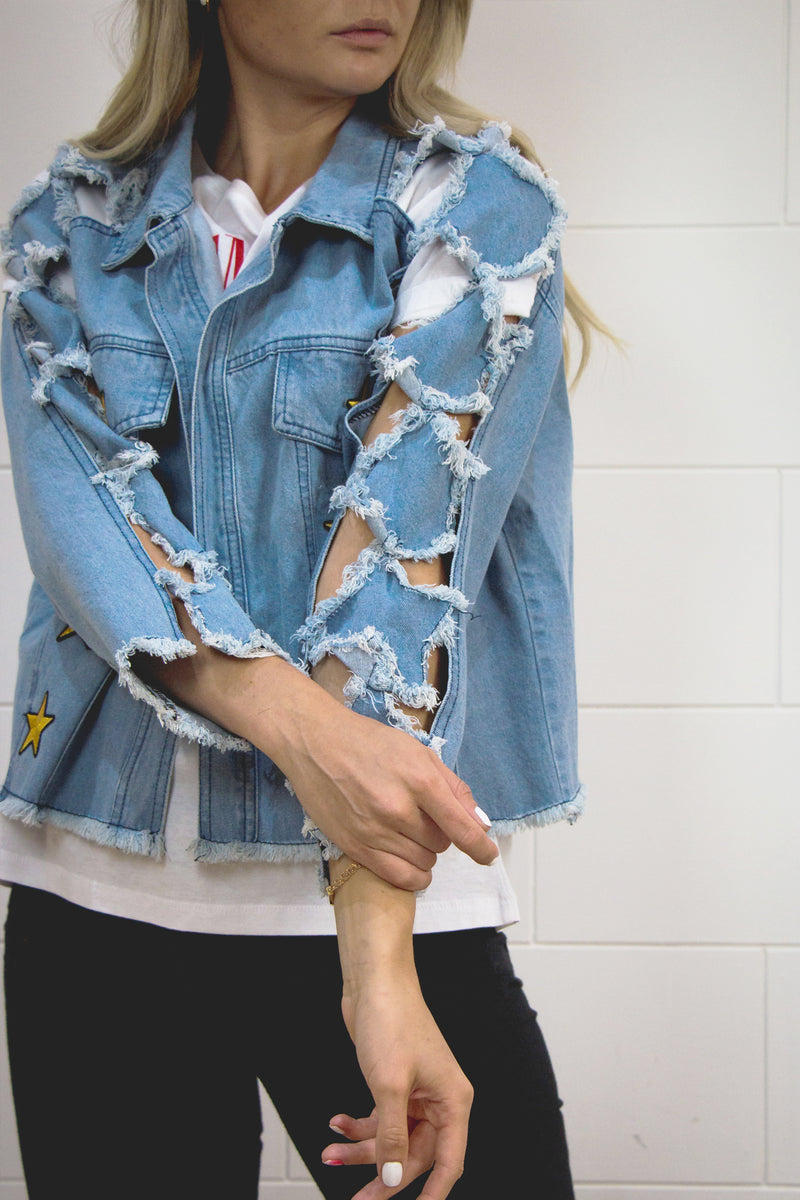 Tatteredآ vintage denim jacket with gold star patches