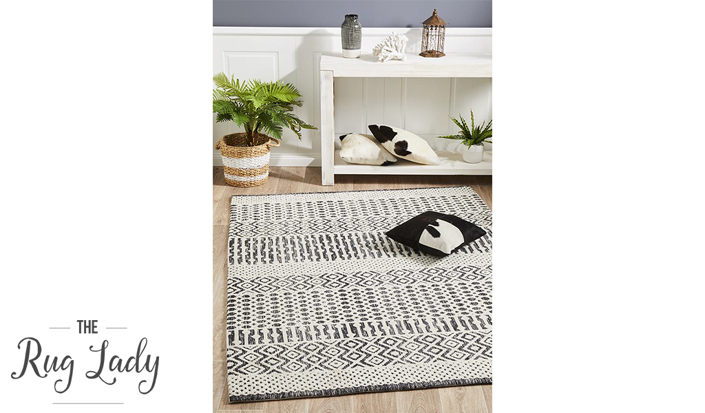 Lenni Ivory Black Tribal Distressed Ornate Rug