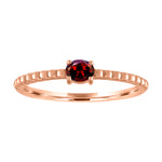 textured band with horizontal oval garnet
