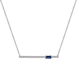 diamond bar pendant with off-center sapphire baguette