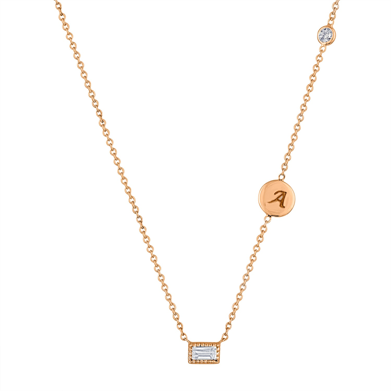 Small single diamond baguette necklace with initial disc and floating diamond