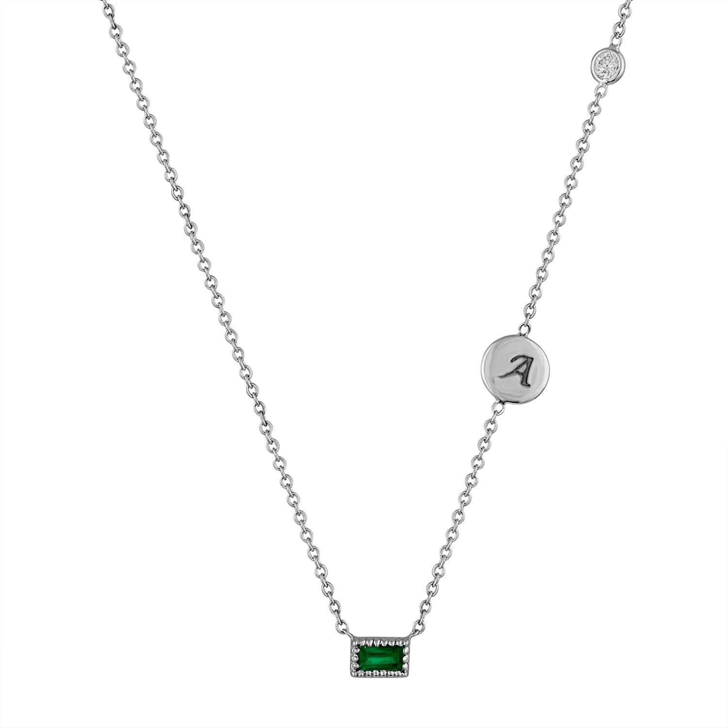 Small single emerald baguette necklace with initial disc and floating diamond