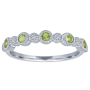 Ana ring with alternating round peridots and diamonds