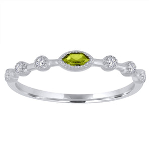 Peridot marquis center with three round stationed diamonds