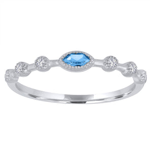 Blue Topaz marquis center with three round stationed diamonds