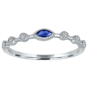 Sapphire marquis center with three round stationed diamonds