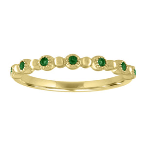 round emerald stones alternate with gold beads