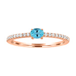 Micropave band with horizontal oval aquamarine center