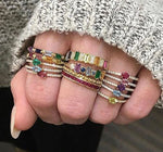 assorted ring stacks with daisy