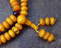 High Quality Imitation Amber Mala with Carnelian Dividers