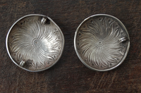 Two Antique Indian Silver Disc Pendants with floral motif