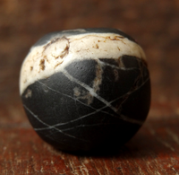 Ancient Black Stone bead with streaks of Quartz - 17mm