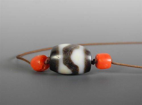 Ancient Tasso dZi Bead with red coral