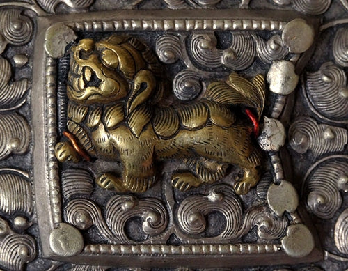 Antique Tibetan belt ornamented with silver snow lion plaques