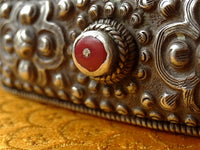 Antique Tibetan belt ornamented with silver studs and plaque