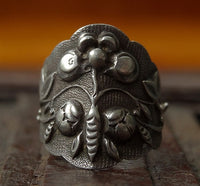 Antique Tibetan Silver Ring with Raised Flower Motif  - 19th C