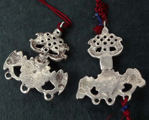 Pair of Antique Tibetan Silver Ashtamangala Pendants