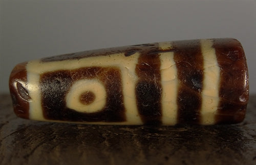 Ancient Four Eyed dZi Bead with ancient break