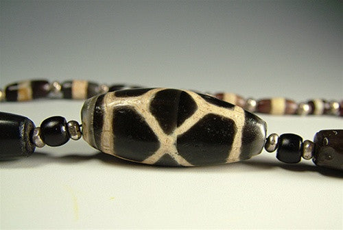 Ancient Phum dZi Bead with decorated agates