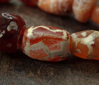 Sixteen Ancient Decorated Carnelian Beads