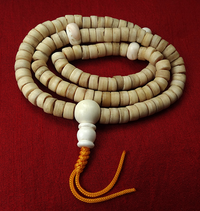 Disc Bead Bone Mala with Conch Guru Bead - 11.5 mm