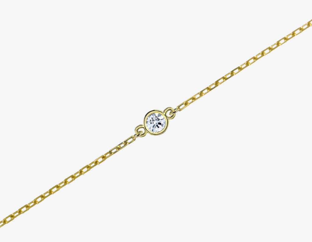 diamond bracelet on a chain in yellow gold