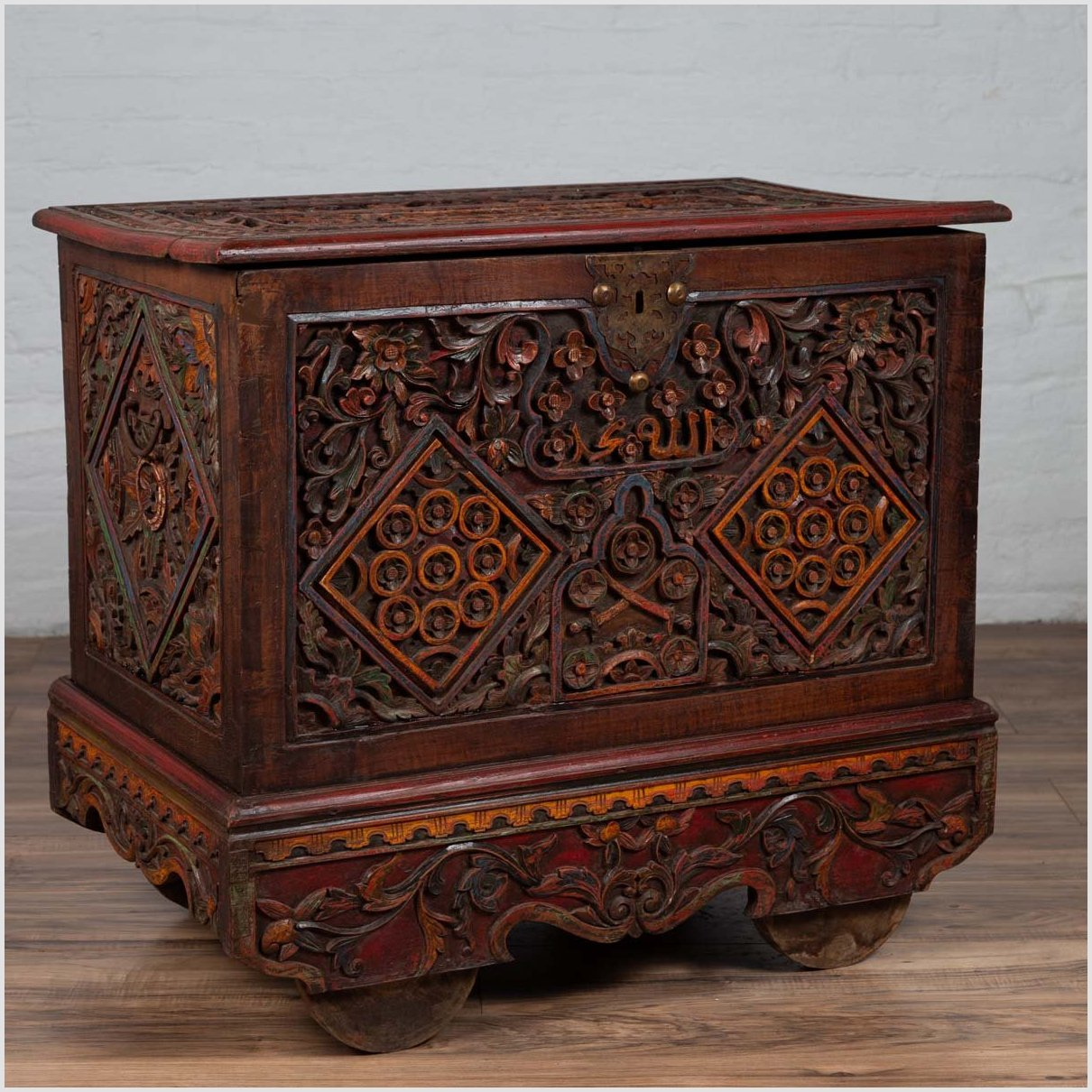 Antique Indonesian Hand Carved Blanket Chest with Polychrome Decor and Wheels