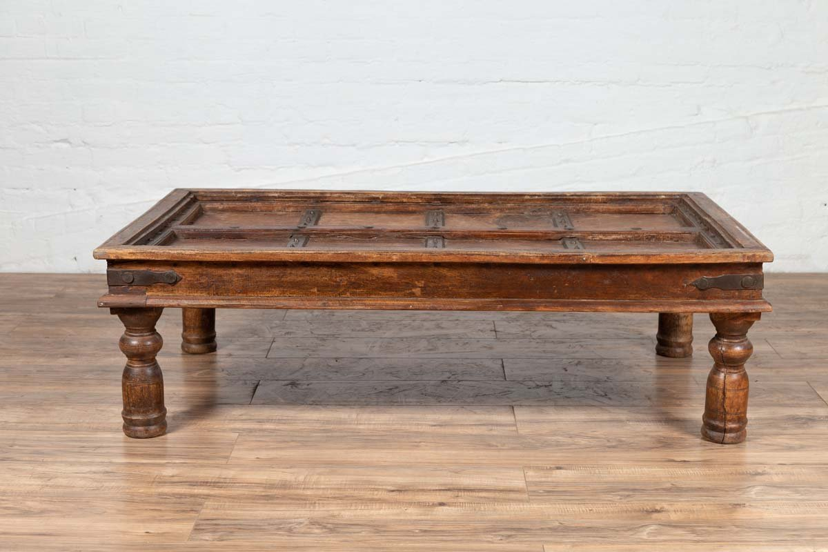 Antique Wooden Indian Palace Door Made into a Coffee Table with Iron Braces