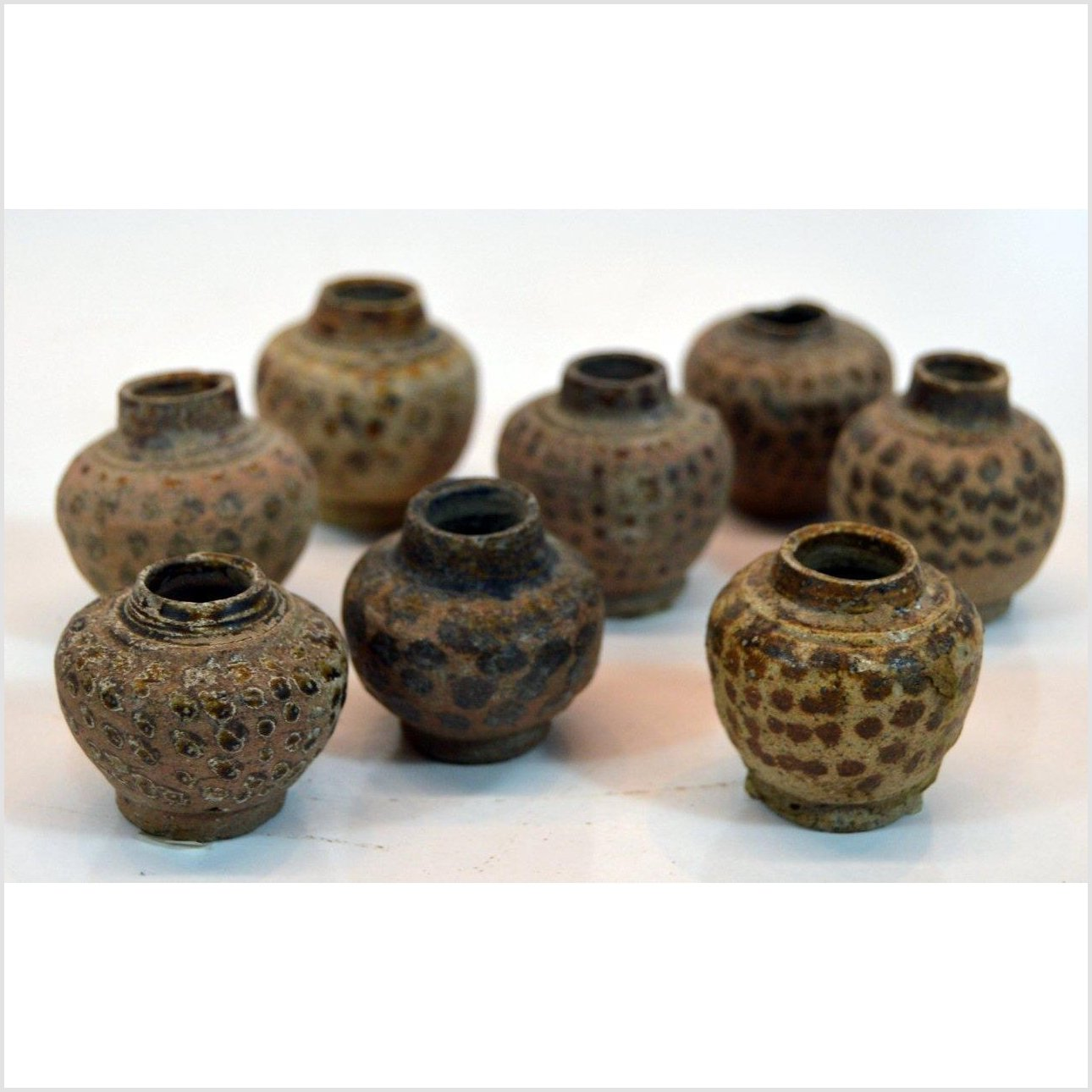 ASSORTED SMALL CLAY VESSELS