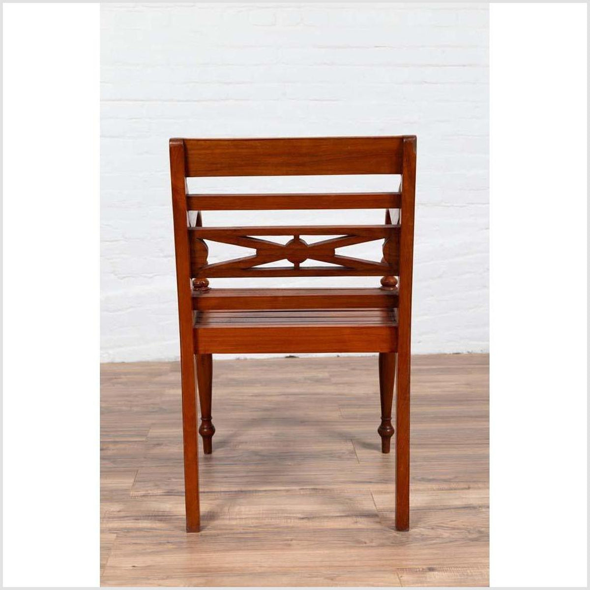 Early 20th Century Captain's Chair from Bali with Slatted Wood