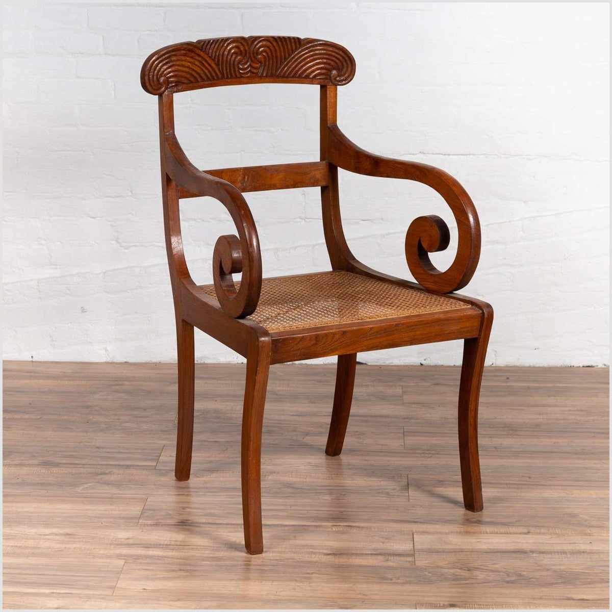 Javanese Antique Armchair with Carved Rail, Woven Rattan Seat and Curving Arms
