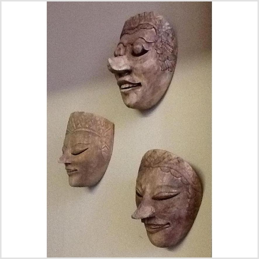 Unpainted Carved Wooden Masks