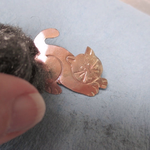 The Fifth Life of the Copper Cat Brooch