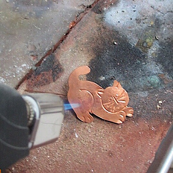 The Seventh Life of the Copper Cat Brooch