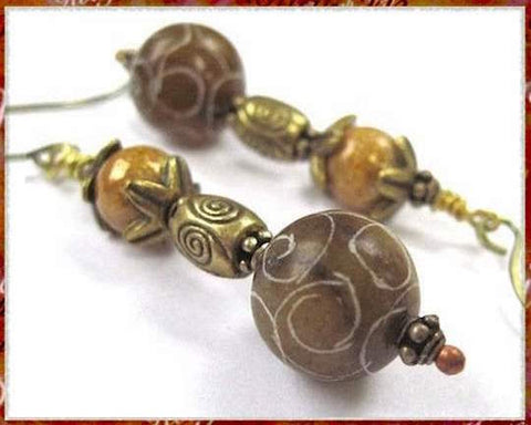 carved-stone-earrings-with-brown-jade-and-antique-brass