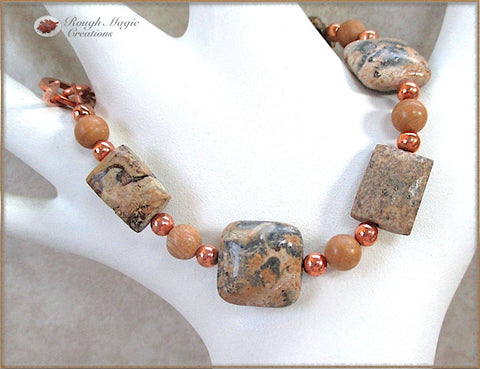 Earthy multicolor jasper gemstone bracelet with tan and gray stones, copper beads and hammer textured copper toggle clasp, handmade jewelry by Rough Magic Creations.