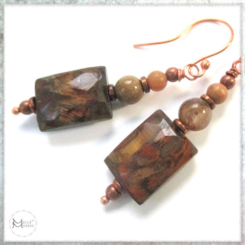 This image shows the earthy color palette of Mollie Meserve's Chatoyant Tigers Eye Gemstone Earrings, handmade jewelry for Rough Magic Creations.