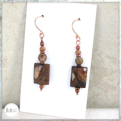 These exotic gemstone earrings, designed and handcrafted for Rough Magic Creations by Mollie Meserve, feature faceted tigers eye gemstones in a rich earth tone palette, crazy lace agate and jasper, and copper accents.