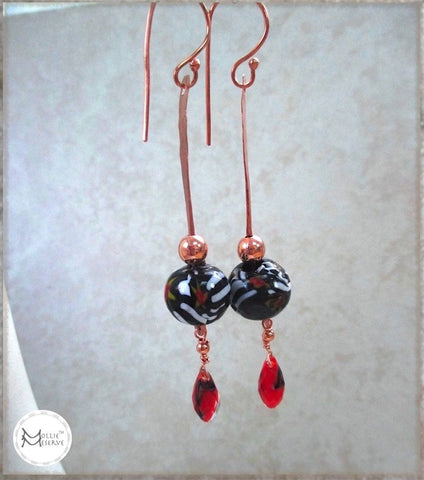 Extra long boho shoulder duster earrings with black and white millefiori tombo vintage glass beads, red teardrops and rustic hand forged copper hook ear wires and hammered dangles.