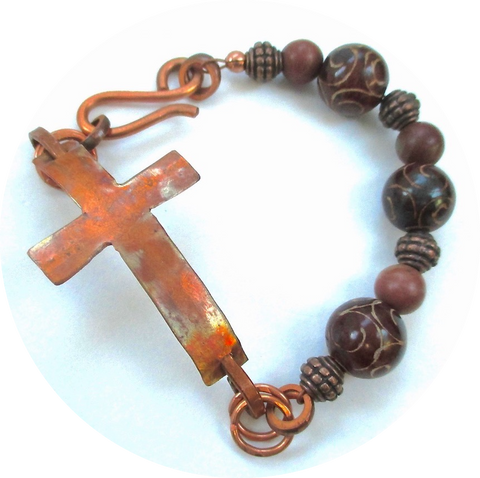 Hammer textured flame washed copper cross bracelet with dark red carved Asian jade gemstones by Mollie Meserve Designs