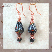 Load image into Gallery viewer, Large Black Statement Earrings with vintage Indian glass, large tomba pear beads, red orange white millefiori Venetian style floral teardrops, abstract jet black crystals, copper, Wabi sabi Earrings, boho style handmade jewelry by Rough Magic Creations.
