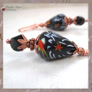 Extra large black earrings, boho dangles with vintage Tombo pear teardrop millefiori red orange yellow white floral beads from India, jet crystals, copper flower petal caps