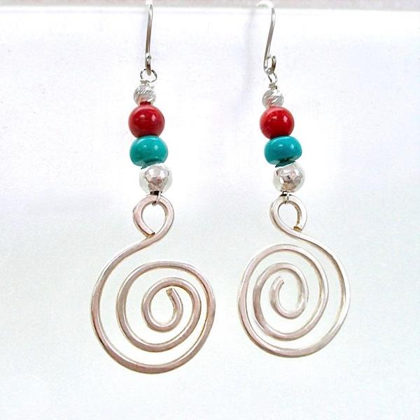 Colorful Turquoise and Red Sterling Silver Earrings. Designed and handmade by Mollie Meserve, these gemstone and sterling silver dangle earrings are long and large, combining colors traditionally associated with the Great American Southwest in a bohemian statement with a tribal flair.