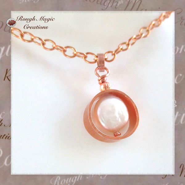 Simple minimalist style pendant on chain necklace with copper and genuine freshwater white coin pearl, handmade jewelry by Rough Magic Creations.