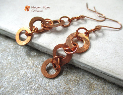 Lone dangle earrings of eco friendly upcycled industrial copper, rustic primitive hammered hand forged washers, rings and hook earwires