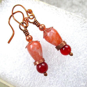 Autumn colors and eclectic style, fall fashion earrings combine old world charm with avant garde style: red and orange gemstones, upcycled copper.