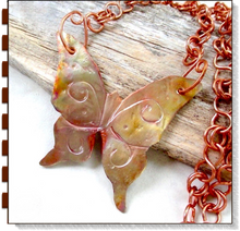 Load image into Gallery viewer, Large copper butterfly necklace colorful hammered metalwork statement pendant on handcrafted chain. 7th anniversary jewelry for women. Designed and handmade in America, in Down East Maine USA by Mollie Meserve Designs at Rough Magic Creations.